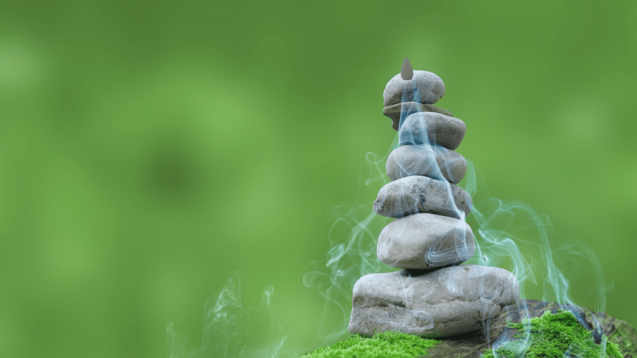 incense waterfall cone burner on top of stacked rocks